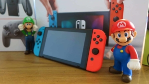 Nintendo Switch with Mario character figurines