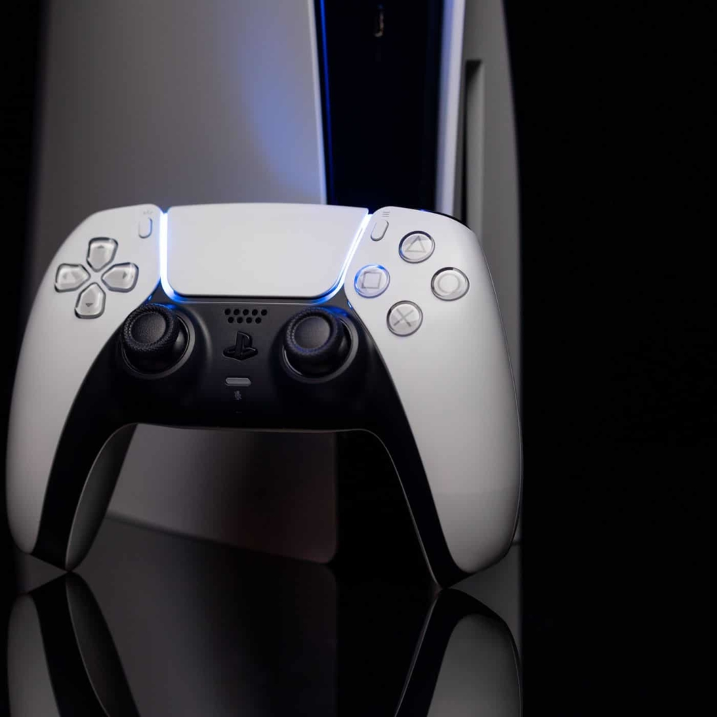 PS5 Controller Propped Against Console