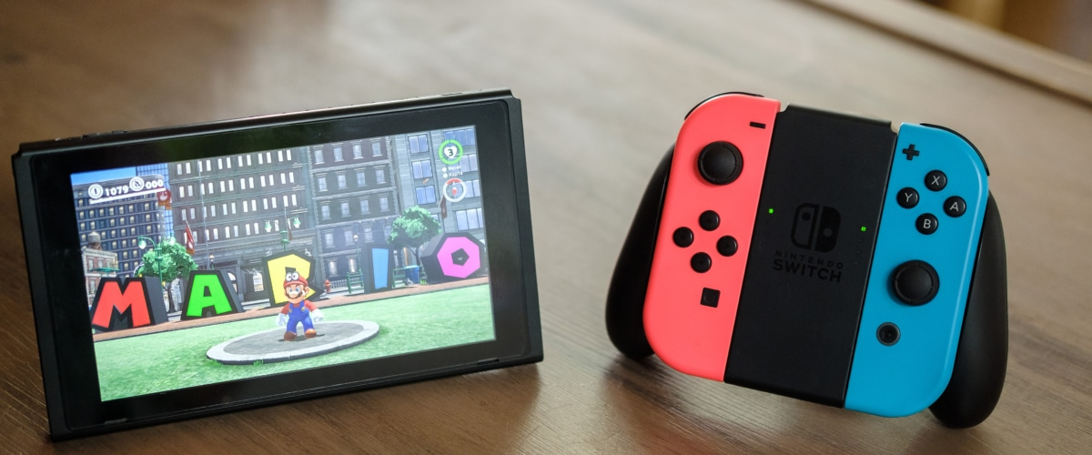 Nintendo Switch & Controller on Wooden Table